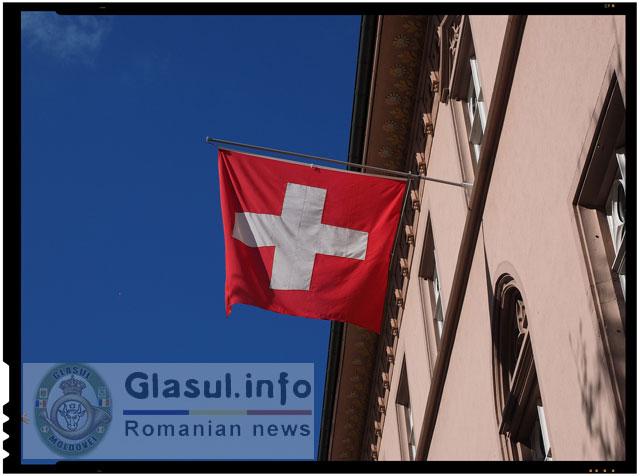 Halucinant! O asociatie a imigrantilor cere Elvetiei sa-si inlature crucea de pe steag!