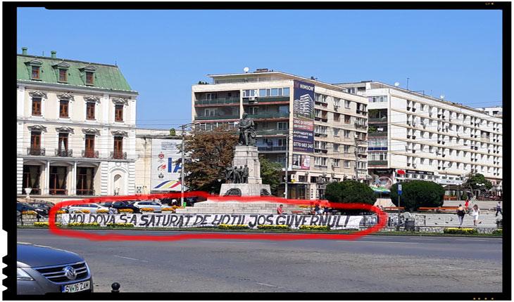 Incredibil! Poliția locală este folosită la IAȘI pentru a păzi un banner antiguvernamental neautorizat?
